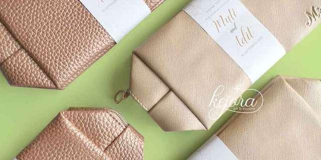 souvenir-pernikahan-murah-pouch-bulat-unik-r18cWI-wD.jpg